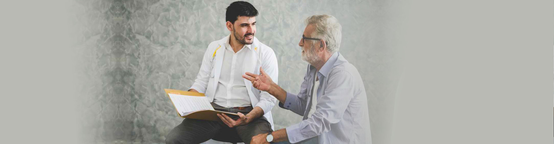 senior man talking to his doctor